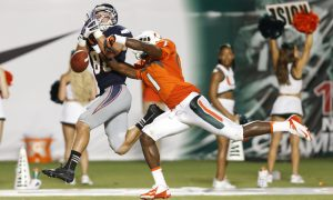 MIAMI GARDENS, FL - AUGUST 30: Artie Burns #1 of the Miami Hurricanes breaks up the pass intended for Jenson Stoshak #88 of the Florida Atlantic Owls on August 30, 2013 at Sun Life Stadium in Miami Gardens, Florida. Miami defeated Florida Atlantic 34-6. (Photo by Joel Auerbach/Getty Images)